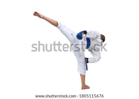 In karategi boy athlete training kick kick on white isolated background Royalty-Free Stock Photo #1805115676
