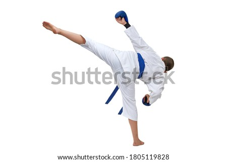 In karategi boy athlete performs a kick on white isolated background Royalty-Free Stock Photo #1805119828