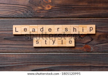 LEADERSHIP STYLE word written on wood block. LEADERSHIP STYLE text on cement table for your desing, concept. Royalty-Free Stock Photo #1805120995