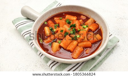 Delicious Korean spicy tteokbokki or ttopoki. The image of spicy tteokbokki on a luxurious background. Available negative space for writing text.  Isolated and copy space. #1805366824