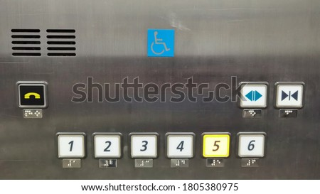 Metal elevator control pane with round button with number of layers button