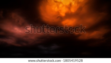 Fantastic concept mystical horror background from another planet from the paranormal world, fantasy style. Dramatic red black orange sky with scary hellish clouds and terrible shadows and fiery light