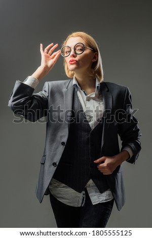School advertising.Sensual female teacher. Silhouette of female teacher in glasses. Education concept. School. Portrait of female teacher in suit. Business concept. #1805555125