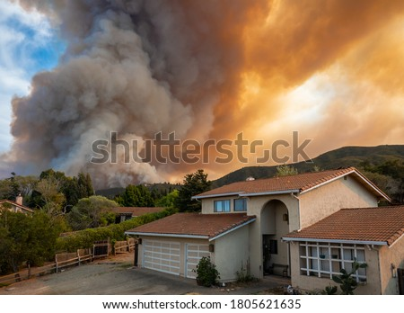 "The California ""River Fire"" of Salinas,  in Monterey County, was ignited by dry lightning on August 16, 2020, fills the sky with dark smoke and flames as it burns close to a houses on its first day.   #1805621635"