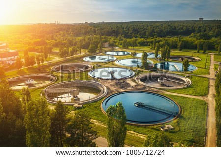 Aerial view of modern industrial sewage treatment plant at sunset Royalty-Free Stock Photo #1805712724