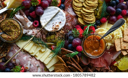 Charcuterie and cheese grazing board Royalty-Free Stock Photo #1805789482