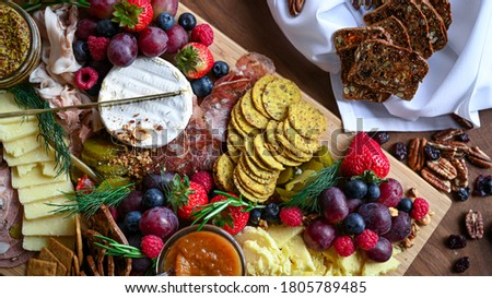 Charcuterie and cheese grazing board Royalty-Free Stock Photo #1805789485