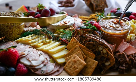 Charcuterie and cheese grazing board Royalty-Free Stock Photo #1805789488