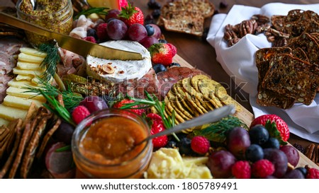 Charcuterie and cheese grazing board Royalty-Free Stock Photo #1805789491