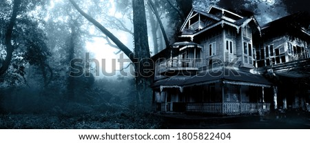 Horizontal Halloween banner with haunted house. Old abandoned house in the night forest. Scary colonial cottage in mysterious forestland. Photo toned in blue color Royalty-Free Stock Photo #1805822404