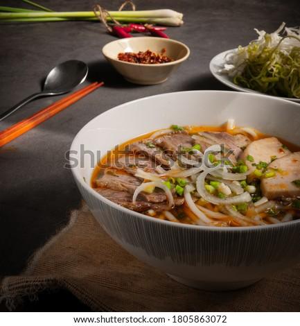 Vietnamese spicy beef noodle soup - Bun Bo Hue - Vietnamese Cuisine Royalty-Free Stock Photo #1805863072