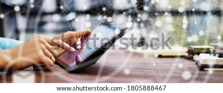 Close-up photo of female hands with digital tablet. Young woman working remotely at home. Concept of networking or remote work. Global business network. Online courses. Royalty-Free Stock Photo #1805888467