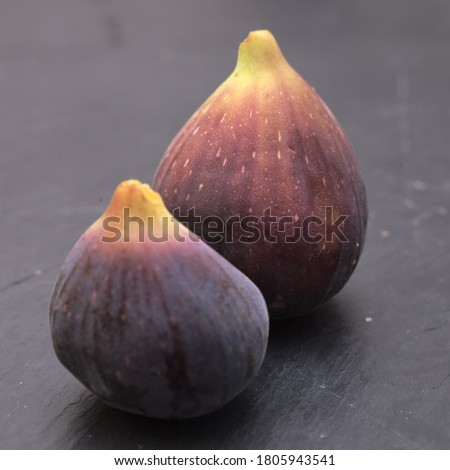Agriculural produce of Gran Canaria - figs on trivet board Royalty-Free Stock Photo #1805943541