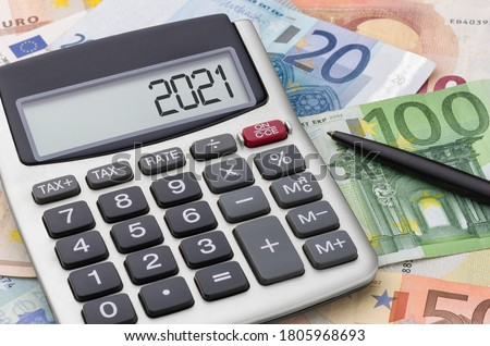 Calculator with money and a pen - 2021 #1805968693