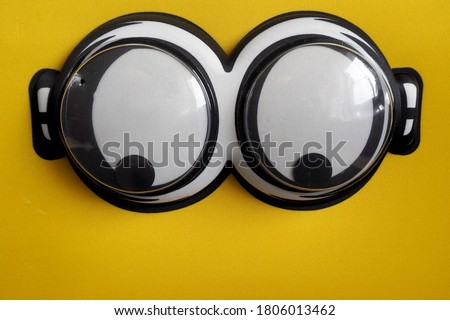 large plastic eyes on a yellow cloth background