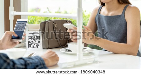Panorama Asian customers scan QR code online menu. Customers sat on social distancing table for new normal lifestyle in restaurant after coronavirus covid-19 pandemic. Royalty-Free Stock Photo #1806040348