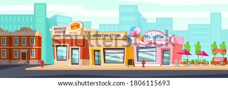 City street with shops, cafes and restaurants.Urban landscape Royalty-Free Stock Photo #1806115693