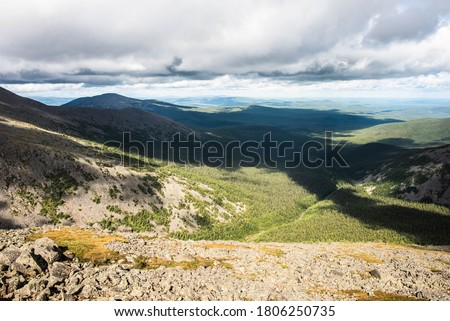The Northern Ural mountains, picturesque view on the Iov ravine, Russia. The ravine is near from the Konzhakovsky Stone, the highest top of Sverdlovsk region. One can reach to this place from Karpinsk #1806250735