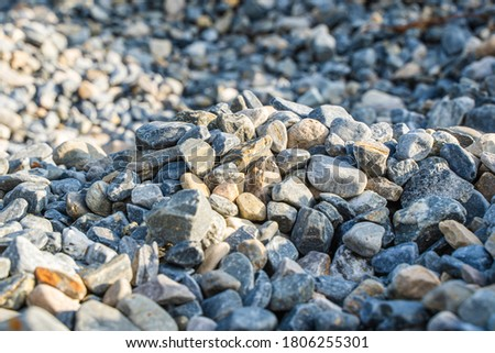 Rubble or gravel background, construction material. Pile of many small stones, stock photo Royalty-Free Stock Photo #1806255301
