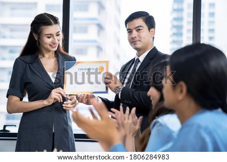 Business executives congratulate employees on their excellent work, Certificate of Excellence or a Certificate for Success in Work, Business people teamwork. #1806284983