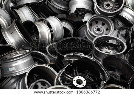 A scrap of old aluminum wheels from a recycling company for the purpose of wallpaper or background. Royalty-Free Stock Photo #1806366772