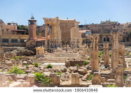 Baalbek temple complex in Lebanon. Massive Roman ruins. View of the columns and the Temple of Venus on the background of the modern city. Royalty-Free Stock Photo #1806410848
