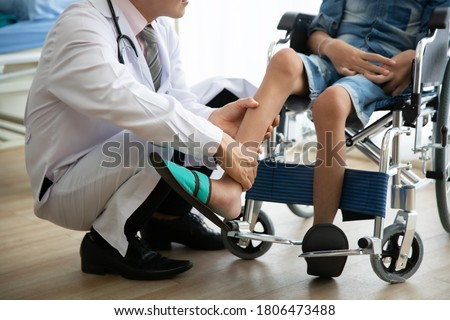 Doctor checking disabled person pateint leg at hospital, Muscle weakness Royalty-Free Stock Photo #1806473488