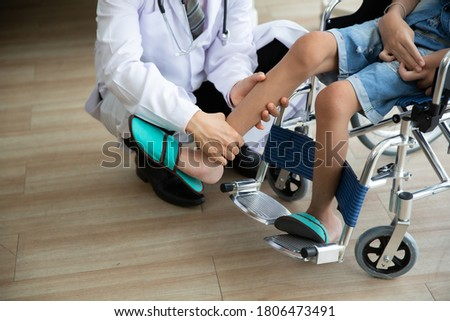 Doctor checking disabled person pateint leg at hospital, Muscle weakness Royalty-Free Stock Photo #1806473491
