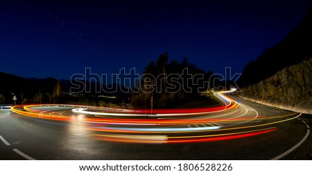 Lights of the cars in the night road turn. Road turn in night car lights. Car lights in night road turn #1806528226
