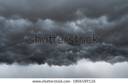 Dramatic dark grey clouds sky with thunder storm and rain. Abstract nature landscape background. Royalty-Free Stock Photo #1806589126