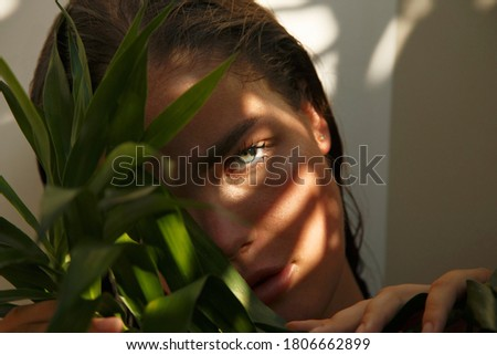Beauty face. Woman model with natural makeup and healthy skin in tropical nature. Spa and wellness. Youth, teens and skin care concept. Close up Royalty-Free Stock Photo #1806662899