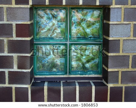 four glass tiles in the wall #1806853