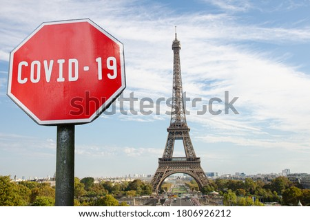 COVID-19 sign with Eiffel tower in Paris, France. Warning about pandemic in France. Coronavirus disease. COVID-2019 alert sign Royalty-Free Stock Photo #1806926212