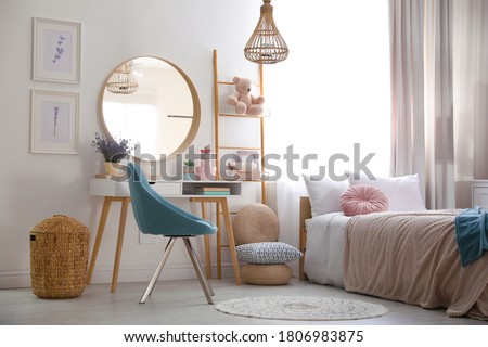 Teenage girl's bedroom interior with stylish furniture. Idea for design Royalty-Free Stock Photo #1806983875
