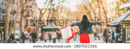 Shopping fun happy woman with bags spending buying new clothes in stores of Barcelona, Spain. Panoramic banner of happy girl with open arms in freedom. Royalty-Free Stock Photo #1807021366