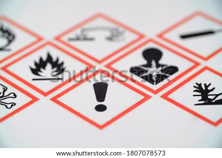 WHMIS 2015 SYMBOLS WORKPLACE HAZARDOUS MATERIAL INFORMATION SYSTEM. EXCLAMATION MARK FOCUSED SYMBOL. FOR INDICATORS AND FOR EMPLOYEE AND EMPLOYER. TOXIC MATERIAL. MAY CAUSE LESS SERIOUS HEALTH EFFECTS Royalty-Free Stock Photo #1807078573