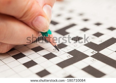 Crossword puzzle close-up.Hand doing crossword #180710084