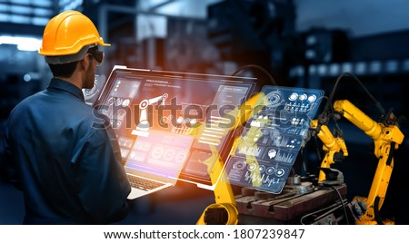Smart industry robot arms for digital factory production technology showing automation manufacturing process of the Industry 4.0 or 4th industrial revolution and IOT software to control operation . Royalty-Free Stock Photo #1807239847