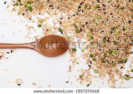 Miscellaneous grains with wood spoon Royalty-Free Stock Photo #1807259668