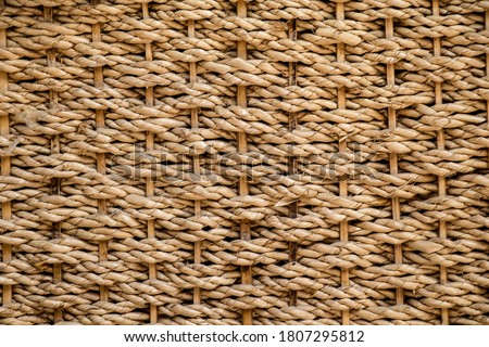 The texture of straw, weaving from straws background Royalty-Free Stock Photo #1807295812