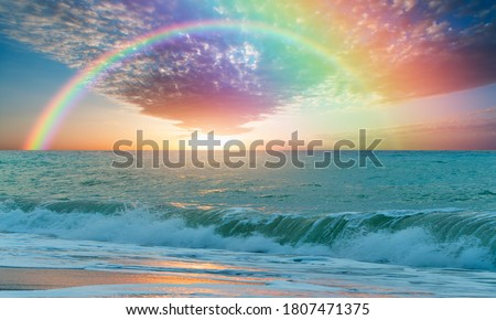 Beautiful landscape with turquoise sea with double sided rainbow at sunset Royalty-Free Stock Photo #1807471375