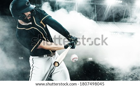 Porfessional baseball player with bat taking a swing on grand arena. Ballplayer on stadium in action. Royalty-Free Stock Photo #1807498045