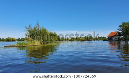 Lake boat view and blue sky from Breukelen #1807724569