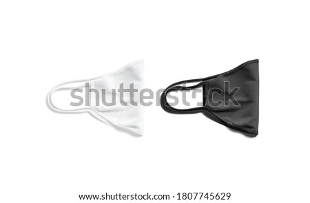 Blank black and white fabric folded face mask mockup lying, 3d rendering. Empty breathing protective for doctor mock up, isolated, top view. Clear masks with cord for pandemic save template.
