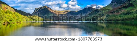 Buttermere lake overlooking Haystacks peak in Lake District. Cumbria, England Royalty-Free Stock Photo #1807783573