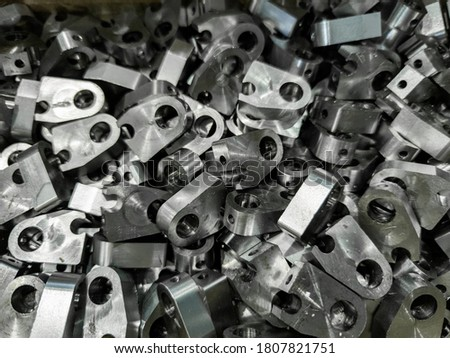 pile of shiny steel parts, full frame industrial background