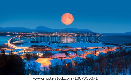 """Urban landscape of Tromso in Northern Norway with full moon - Arctic city of Tromso with bridge -Tromso, Norway """"Elements of this image furnished by NASA"""" #1807935871"""