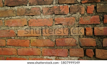 Attractive view of red brick wall texture grunge background with vignetted corners. Stylish rectangular shaped brick.