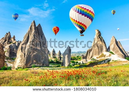 Travel concept. The great tourist attraction of Cappadocia - balloon flight. Cappadocia is the best places to fly with hot air balloons. Goreme, Cappadocia, Turkey. Artistic picture. Beauty world.