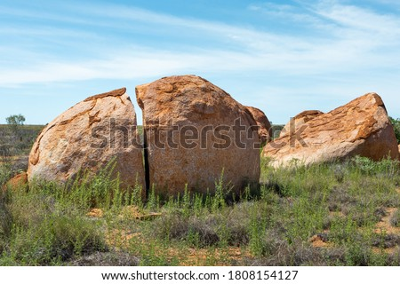 Close up picture of Devils Marbles. Sacred aboriginal place with massive granite boulders. Symbol of Australia's outback. Aboriginal name Karlu Karlu (round boulders). Tennant Creek, NT, Australia